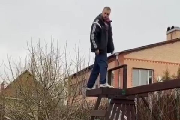 Krylia Sovetov Samara's Dmitri Kombarov thinks about a backflip off a swingset in his garden