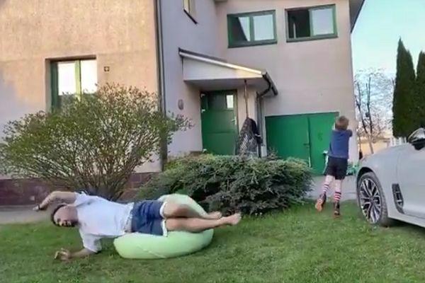 Yevgeny Savin tries to kick ball through a window