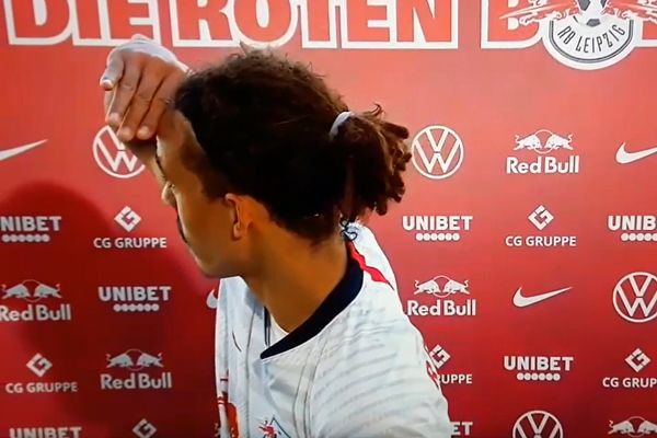 RB Leipzig's Yussuf Poulsen looks for interviewer in long distance post-match interview