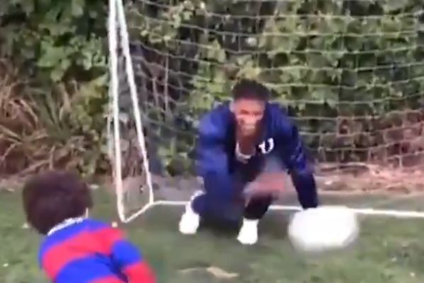 Anthony Joshua saves a shot from his young son with glee