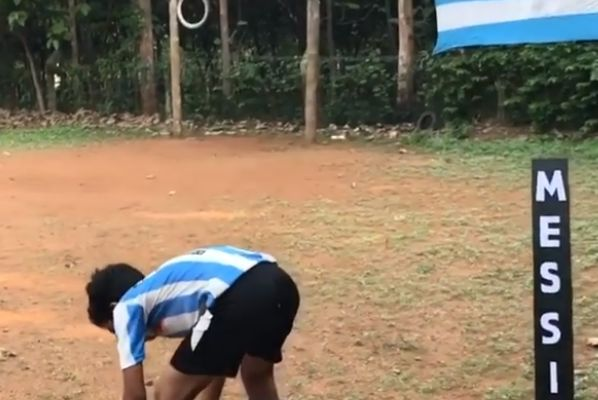 12-year-old Mishal Abulais impersonates Lionel Messi taking a free kick for Argentina