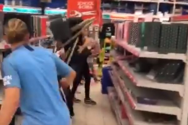 Man in Manchester City kit startles shopper with fake shot
