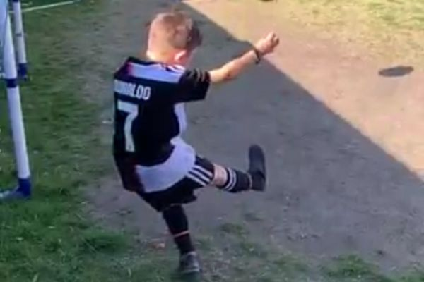 Boy smashes shed window with free kick in the garden