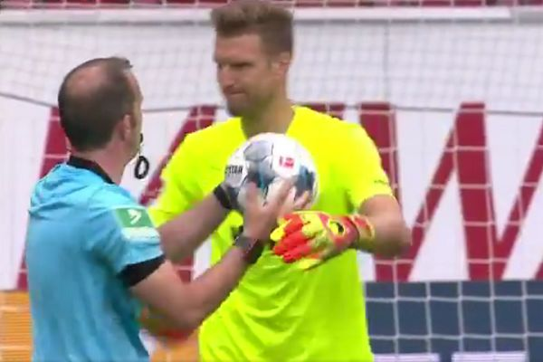 Augsburg goalkeeper hugs referee after win at Mainz