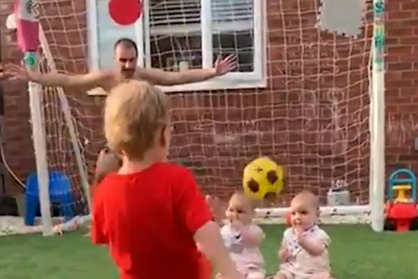 Child dips ball over wall of babies and into the goal