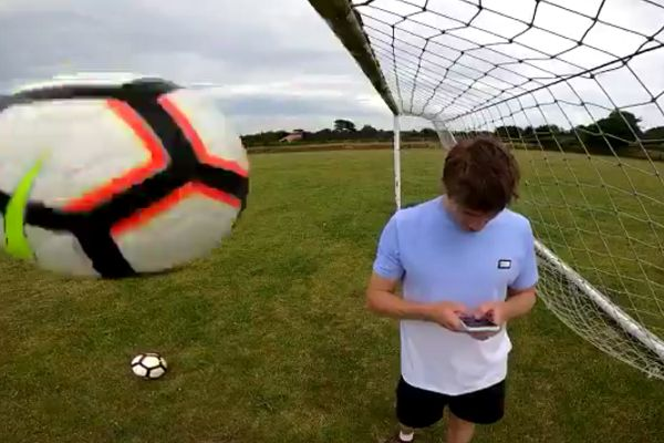 YouTuber W2S hit in the face by ball while looking at his phone