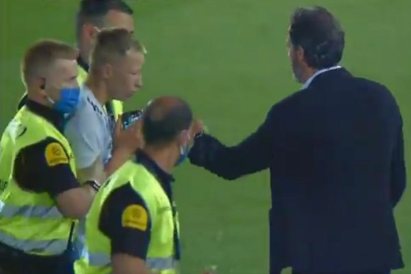 Pitch invader takes photo with Messi in Barcelona's behind-closed-doors match at Mallorca is escorted out