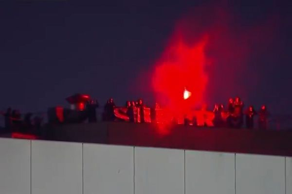 Porto fans watch behind-closed-doors game from roof of stand