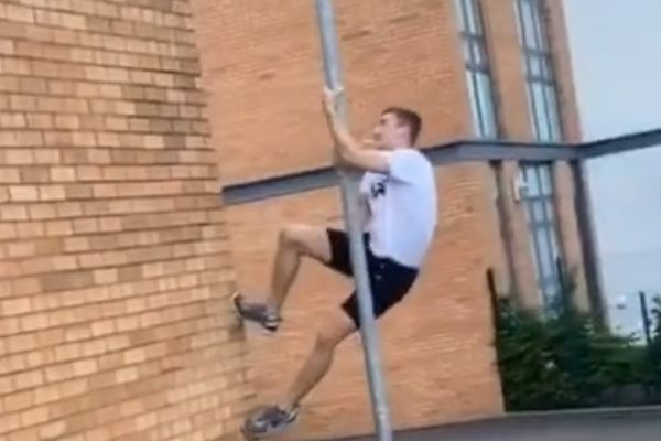 Boy climbs lamp post to get ball back, ends up finding loads