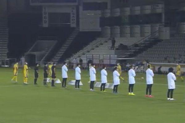 Al Sadd team dress as medical staff before match against Al Khor