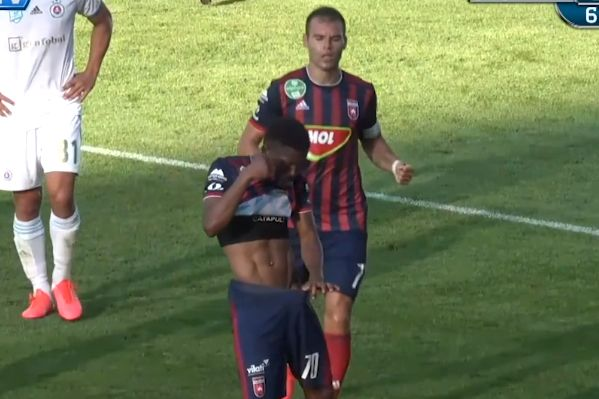 Fehérvár forward Funsho Bamgboye looks down his shorts celebrating goal against Slovan Bratislava