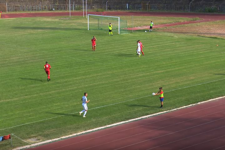 Csepel ball boy throws ball away from a Soroksár player during Hungarian Cup game