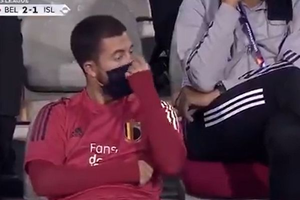 Eden Hazard tells a Belgium staff member to lift his mask over his nose during the win over Iceland