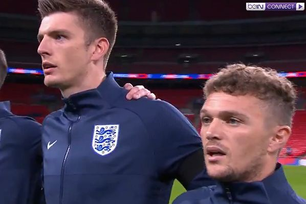 "Kieran Trippier leads the England team in singing ""God Save the Queen"" before the 3-0 win over Wales"