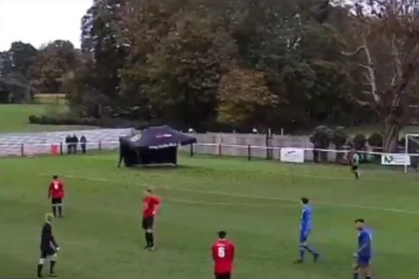 Gazebo blows onto the pitch during Tring Athletic vs Oxhey Jets
