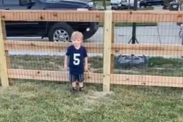 Young boy dives late and the wrong way in front of dad's shot