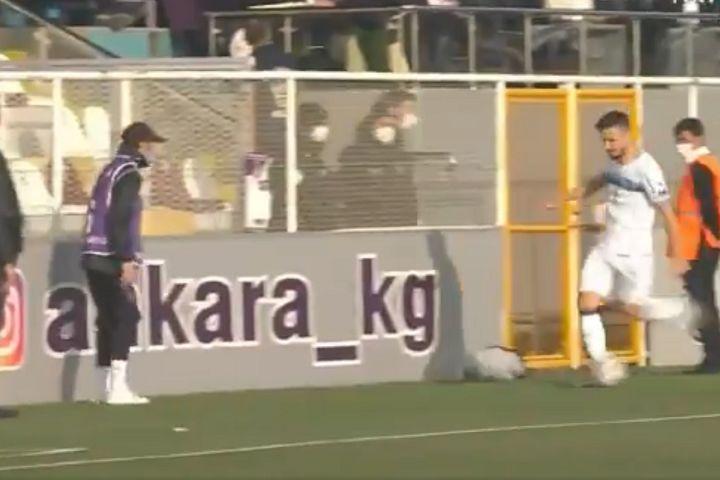 Adana Demirspor's Anıl Karaer kicks ball at Keçiörengücü ball boy