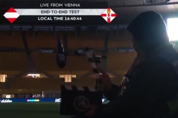 Man sounding clapperboard told to stop over walkie talkie before Austria vs Northern Ireland