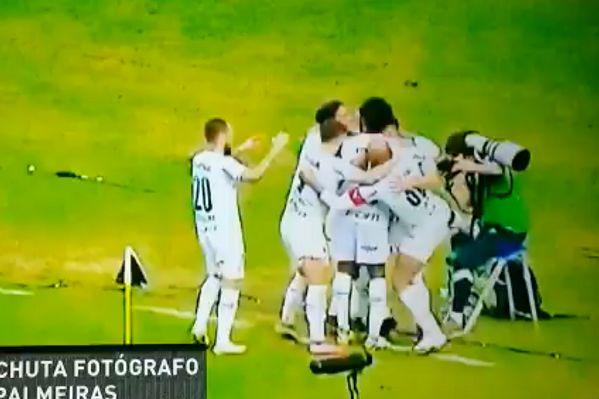 Palmeiras captain Felipe Melo kicks club photographer Cesar Greco during goal celebration at Vasco da Gama