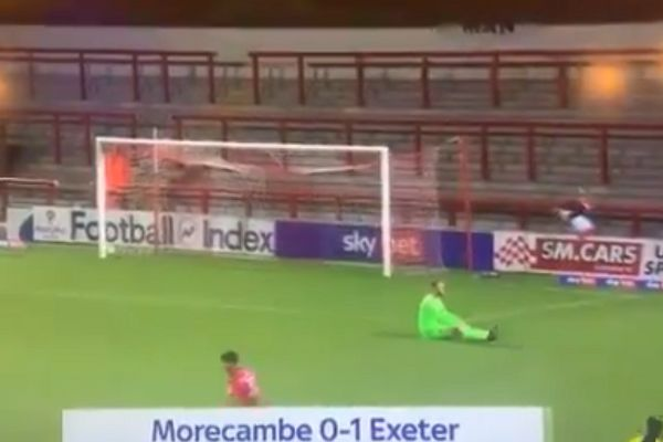Morecambe's Chris Dyson ends up upside down after Exeter score
