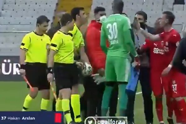 Sivasspor's Hakan Arslan tries to show referee a replay on his phone and gets sent off during 3-0 defeat to Besiktas