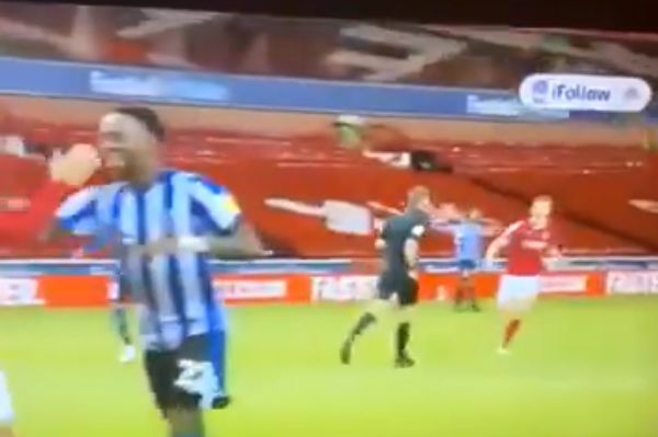 Sheffield Wednesday's Moses Odubajo appears to high-five Nottingham Forest goal-scorer Lewis Grabban