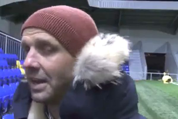 Man slips while warming up behind Bristol Rovers manager Paul Tisdale during TV interview