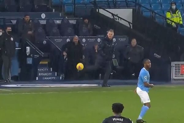 Dean Smith backheel-volleys Tyrone Mings's misplaced pass during Man City vs Aston Villa
