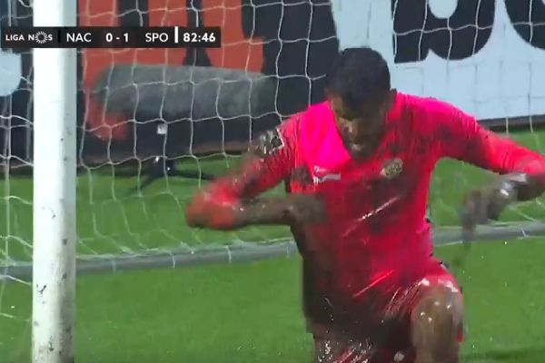 Nacional goalkeeper Daniel Guimarães gets caked in mud trying to save Pote's shot during 0-2 defeat to Sporting