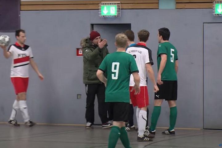 VfL Kemminghausen's Marcel Großkreutz argues with man behind door he ran into