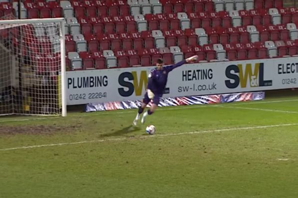 Newport County goalkeeper Tom King scores with goal kick during match against Cheltenham Town