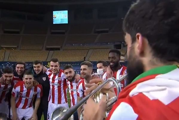 Athletic Bilbao's Asier Villalibre plays trumpet during celebrations after Supercopa win over Barcelona