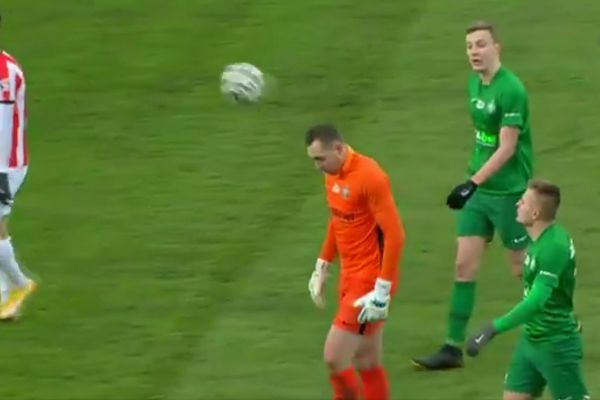 Warta Poznań goalkeeper Adrian Lis bounces the ball onto his own head