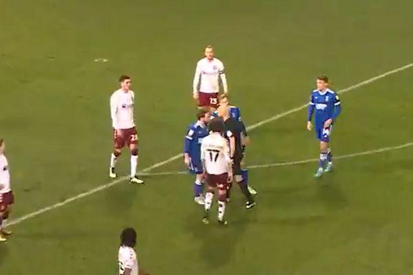 Referee Darren Drysdale squares up to Alan Judge during Ipswich 0-0 Northampton