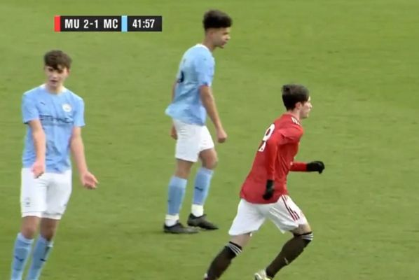 Man City players stand back and let United's Charlie McNeill score during U18 Manchester derby