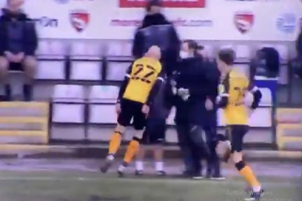Kevin Ellison celebrates in Derek Adams's face after scoring for Newport at Morecambe