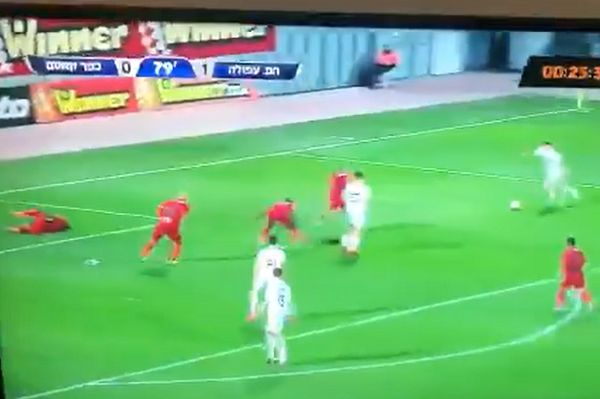 Shay Ben David scores for Hapoel Afula against Kafr Qasim with a deflection off an injured player