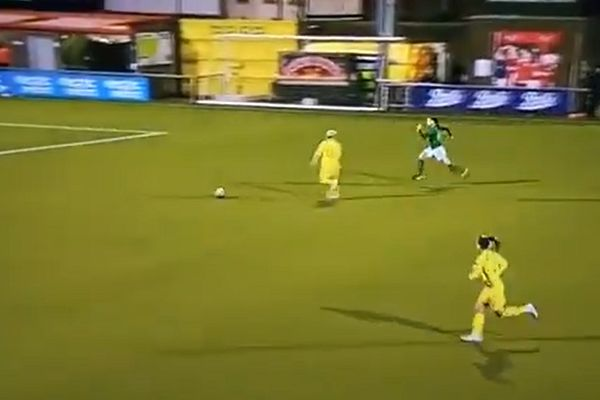 Ukraine's Natiya Pantsulaya swerves away from ball to clatter Northern Ireland opponent