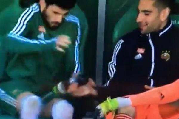 Paul Gartler squirts water bottle on Taxiarchis Fountas's crotch during Rapid Wien 3-0 LASK