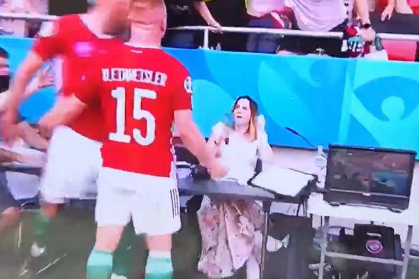 Hungary's Attila Fiola sends reporter's notes flying while celebrating Euro 2020 goal against France