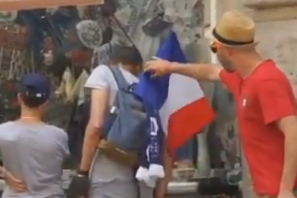 Portugal fan steals French supporter's flag and replaces it with a Portuguese one at Euro 2020