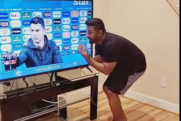 Man pretends to ask Cristiano Ronaldo to pass two bottles of Coca Cola through his television
