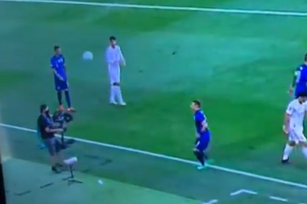 Cameraman heads ball back to Slovakia player during 0-5 defeat to Spain at Euro 2020
