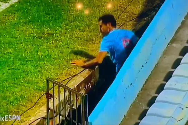 Tampico Madero player falls down trench beside pitch during game against Leones Negros