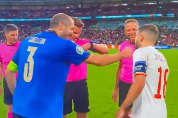 Giorgio Chiellini playfully punches Jordi Alba as the captains meet for coin toss before Italy's penalty shootout win over Spain in semi-finals of Euro 2020