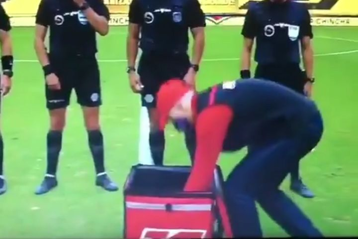 Match ball delivered to referee in food delivery bag in Ecuadorian league game